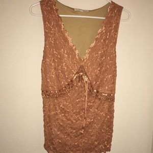Sleeveless top with beads and ribbon